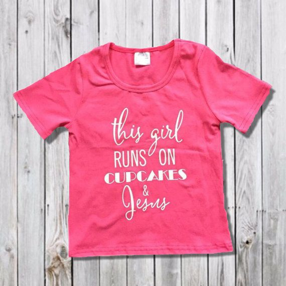 """""""This Girl Runs On Cupcakes & Jesus"""" hot pink girls boutique top. Made of comfy cotton and spandex...dress it up or with a big bow headband and a cute skirt or leggings. Cute for Easter!     Girl's T-Shirt    Matching Headbands  https://www.etsy.com/listing/259764227/girls-valentines-day-headbands-easter    https://www.etsy.com/listing/258466610/hot-pink-girls-womens-knotted-headband    Matching necklace  https://www.etsy.com/listing/258173985/valentine-hot-pink-diamond-chunky    Find more…"""