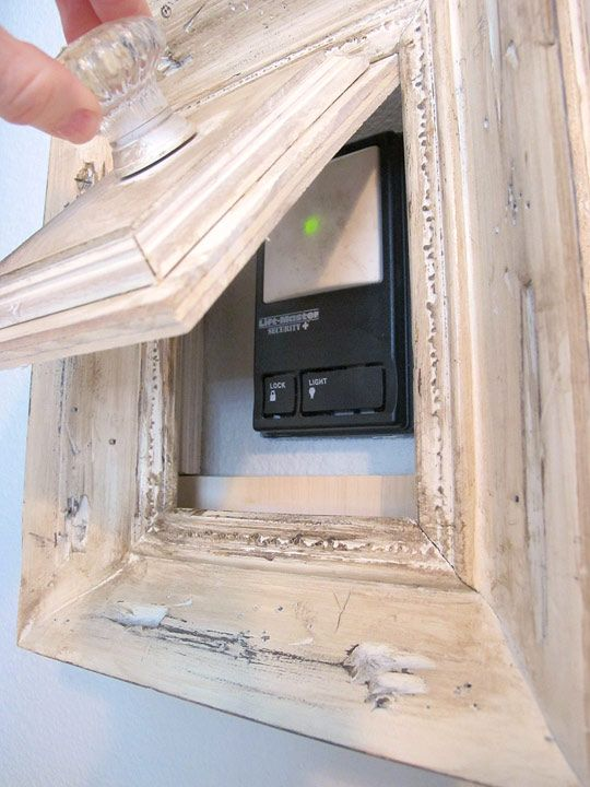 Old frame and scrap wood to hide something less attractive. I will want to do this with all four thermostats at the new house!!!!