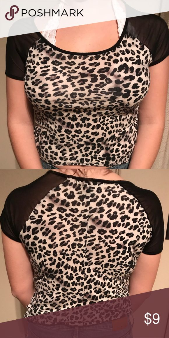 forever 21 cheetah print shirt size small great condition, no wear or tear. high low short, higher in front, longer in the back. shoulders are black mesh, super cute with black jacket or black pants :-) Forever 21 Tops