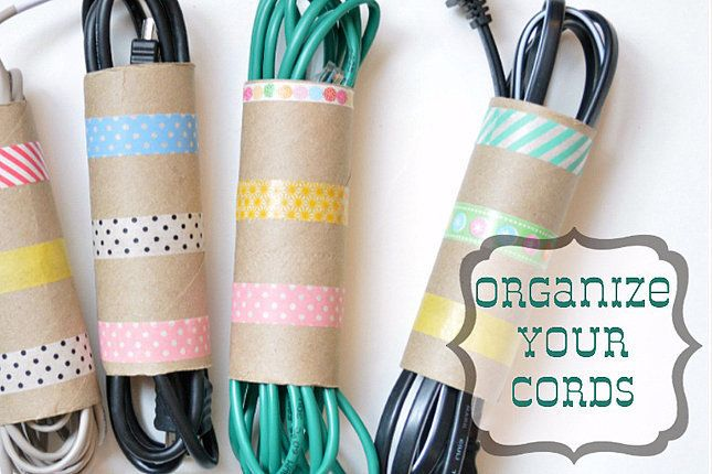 Organize your cords with washi-tape-decorated toilet rolls.