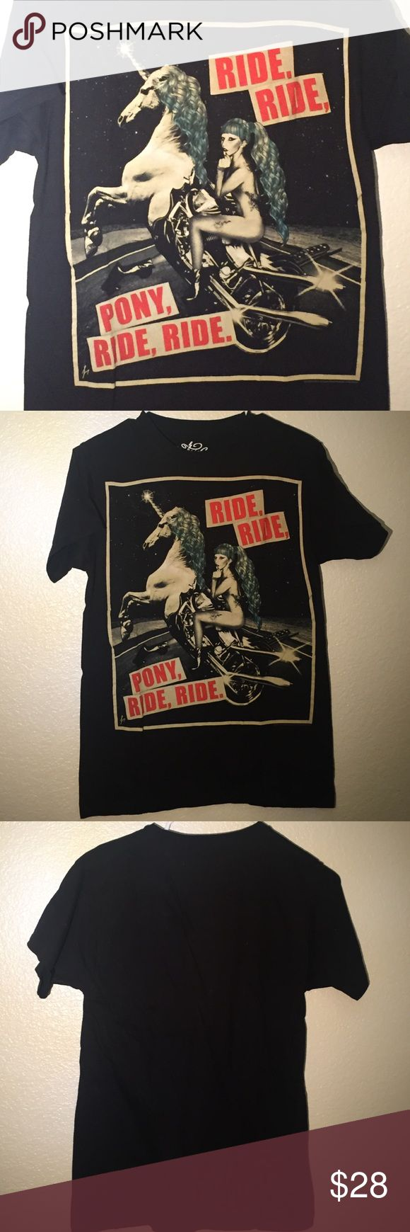 """Lady Gaga limited edition BTW ball t-shirt Rare limited edition Lady Gaga, Born This Way Ball Tour merchandise. Graphic of nude Gaga riding a unicorn with the lyrics """"Ride Ride Pony, Ride Ride"""" like new, only worn once Tops Tees - Short Sleeve"""
