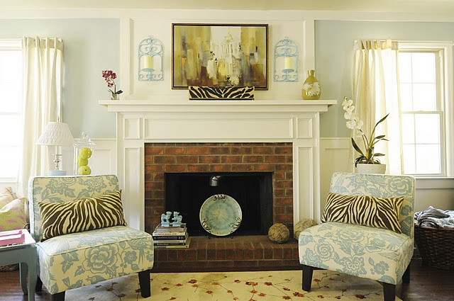 mantel built over existing plain brick fireplace...idea for upstairs bedroom.