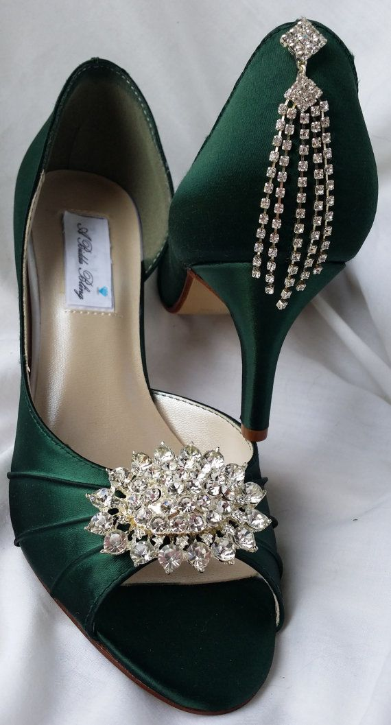 Hunter Green Bridal shoes with a sparkling large crystal oval brooch design on the front of the shoe and a cascading crystal design on the back of the shoe. The shoes in the listing are Hunter Green but are also available in white, ivory and a rainbow of colors custom made just for you! The heel height shown is 2 1/2 inches but is also available in a 3 1/2 inch heel and a 1 3/4 inch heel. Also available is a 1 inch wedge. Please let me know if you would like a different color than the hunter…