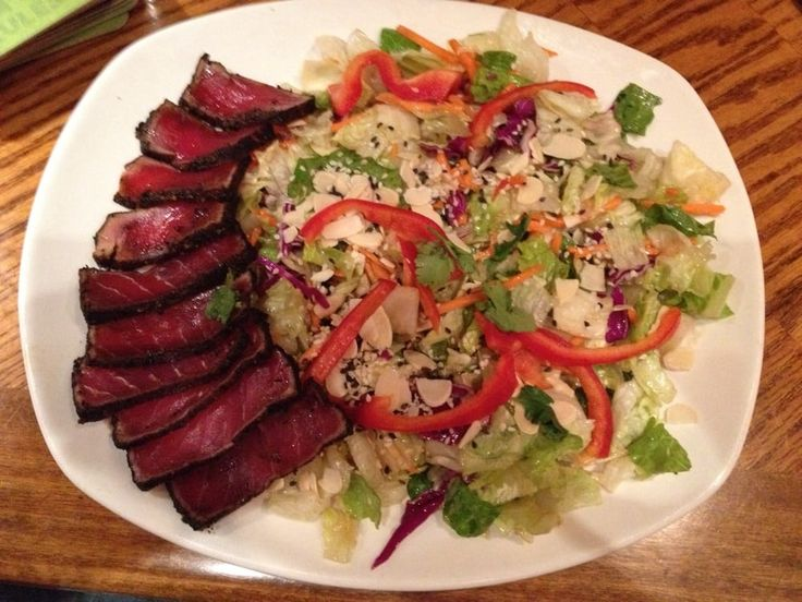 This Salad At Outback Steakhouse Has Mixed Greens Red Peppers Chopped Cilantro Sliced Almonds