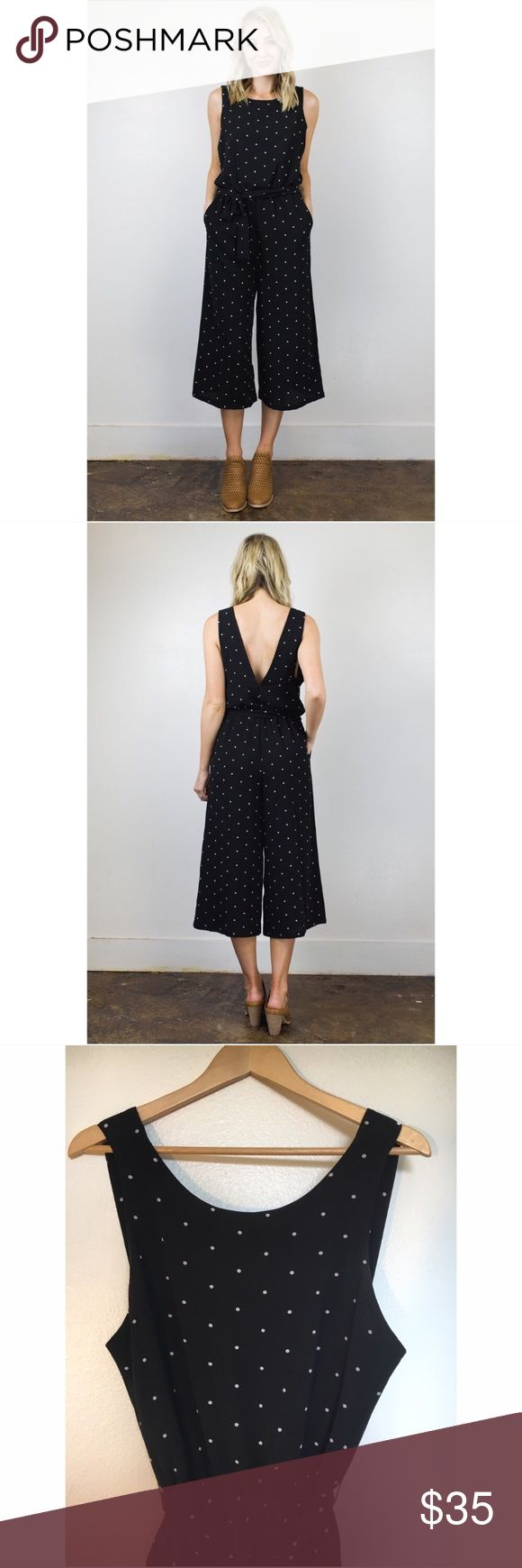 Culottes black drop back jumpsuit size S Adorable belted jumpsuit with elastic waist and drop back. It's size as a S but could fit a M. Anthropologie Pants Jumpsuits & Rompers