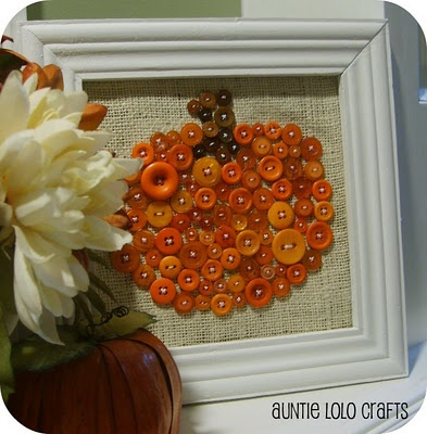 Draw a pumpkin on canvas, cover it with buttons, then frame it. So Cute!