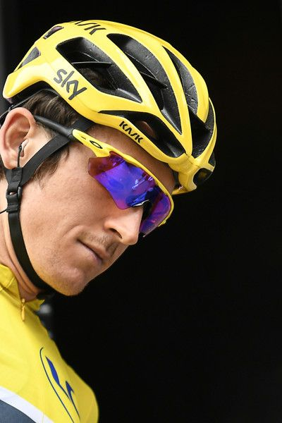 Great Britain's Geraint Thomas wearing the overall leader's yellow jersey attends the signature ceremony prior to the start of the 203,5 km second stage of the 104th edition of the Tour de France cycling race on July 2, 2017 between Dusseldorf, Germany and Liege, Belgium. / AFP PHOTO / Lionel BONAVENTURE
