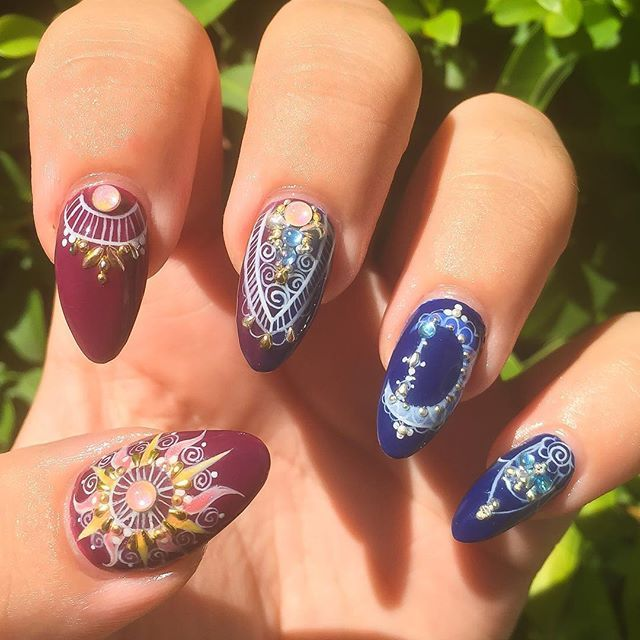 Finally got to do my left hand Sun and Moon nails hard gel overlay, hand painted designs using all @youngnailsinc gel with studs and new stones from @oceannailsupply ✨