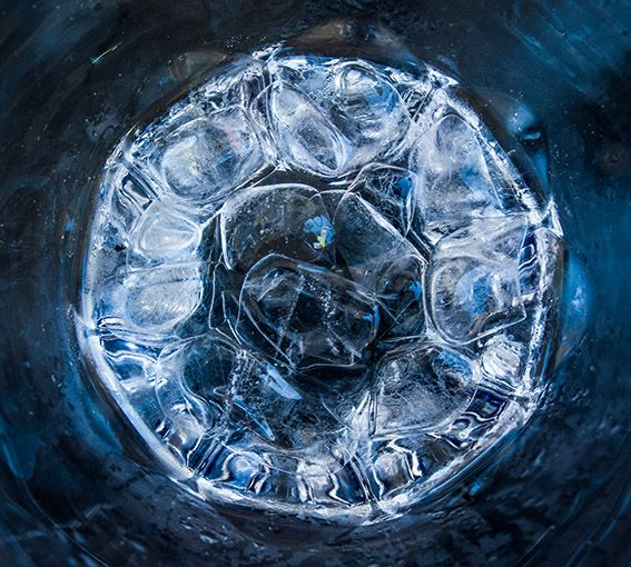 Ice cubes in the bottom of a glass
