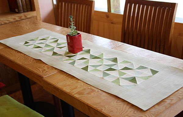 From the Woorikyubang Center in Seoul (an education center for traditional craft), a table runner of half-square triangles in nice muted greens. with a wide border.