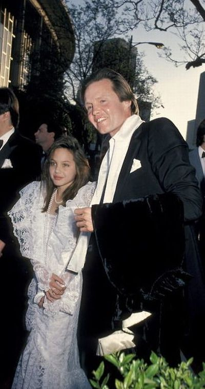 Jon Voight and daughter Angelina Jolie (in a dress that looks about five sizes too big), 1986.