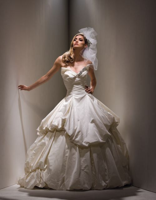 2000's Crinoline inspired wedding dress: Vera Wang's take on Carrie Bradshaw's wedding dress in Sex and The City the movie.