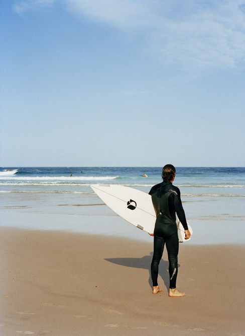 Surfer on beach #wollongong #nsw #beach