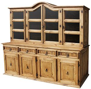 This is our largest rustic southwestern cupboard.  It has an attractive bonnet top, and the two flat ends are ideal for displaying a decorative plate or potted plant.  The lower cabinets and drawers provide ample space for linens and large odd shaped serving bowls.  You will love the sturdy hand made construction of this piece of solid pine furniture, and the rustic styling blends well with other decor. Glass for the cabinet doors is now included with every rustic cupboard!