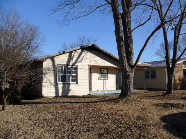 Home in town for sale! This is a 3 bedroom, 1 bath home in town. This home features spacious living room, nice hardwood flooring, double pane vinyl windows, blown insulation, attached 1 car carport, new metal roof & hot water heater. This property includes large shade trees, paved street, plus alley access. Great location approximately 2 blocks from the hospital! This property is located in Howell County, at 1423 W. 5th Street, in West Plains, MO 65775.