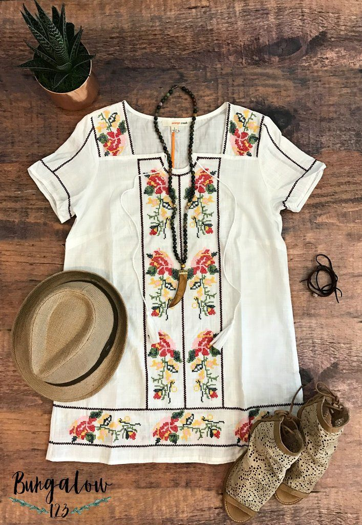 Great Spring and Summer Tunic featuring colorful embroidery along the front and hem. Great over denim or a pair of our B123 Seamless Capri Leggings. Front tie at top may be worn tied or undone. Model