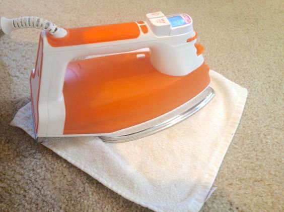 Banish carpet stains without excessive scrubbing by using your iron. | 42 Ways To Make Your Entire Home Cleaner Than It's Ever Been