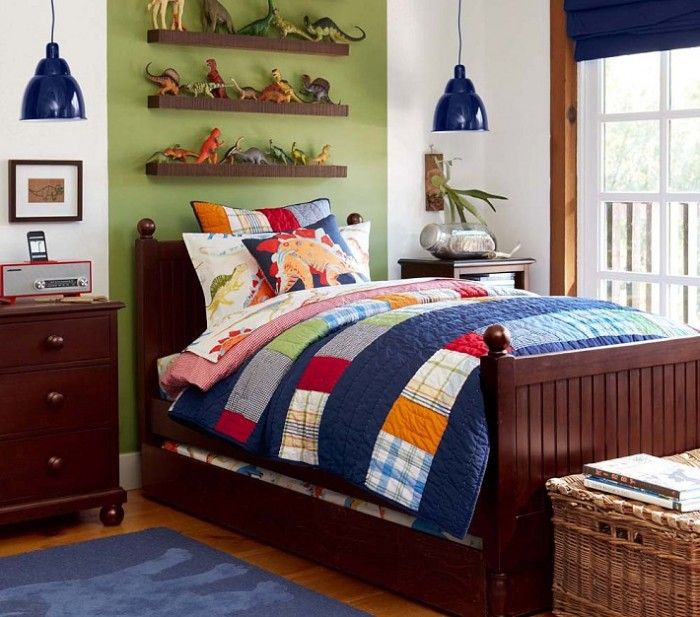 Blue Patchwork Quilt And Two Pendant Lit Also Solid Wood Dresser And Shelf In Green Wall