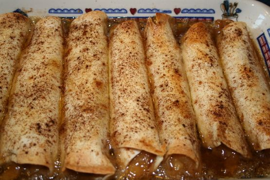 Easy Apple Pie Enchiladas  --  canned pie filling rolled up in flour tortillas and covered with a buttery, brown sugar syrup and baked.
