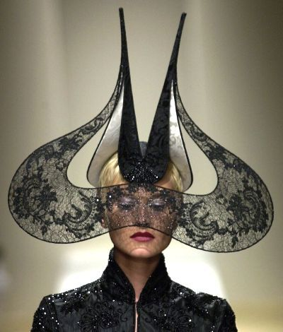 """Clearly, hats can fit the category of """"art to wear"""". And what better way to pay homage to an artist than to wear something in his or her honor? I was left wondering if this idea was what inspired Philip Tracey to create this hat , which resembles Dali's mustache."""