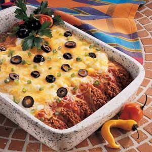 I made this this weekend (minus the olives, ick).  Justin loved it.  It was super easy.  Way easier than my Italian Manicotti Recipe, which requires that you cook the noodles before stuffing them... an impossible task.