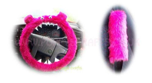 (via fuzzy pink monster car steering wheel cover and seatbelt...