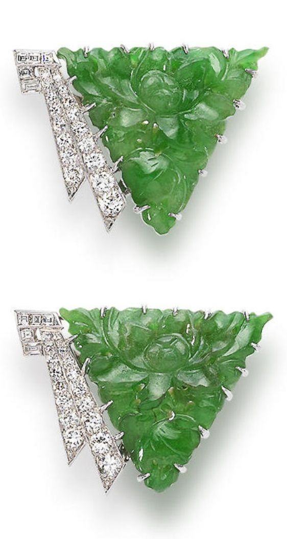 A Pair of Art Deco Jadeite and Diamond Clips, by Boucheron, Circa 1930. The triangular-shape carved floral jadeite plaques of bright green colour, each measuring approximately 23.8 x 26.4 x 4.2mm, accented by old brilliant, single and baguette-cut diamonds, signed Boucheron, length 3.3cm. #Boucheron #ArtDeco #clip