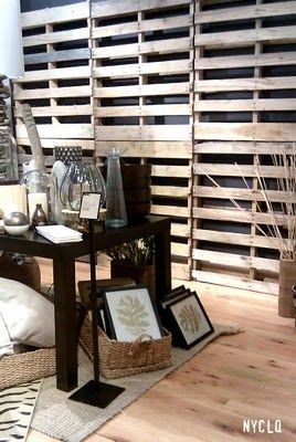 So much potential with a pallet wall! Could hang items and decoration...