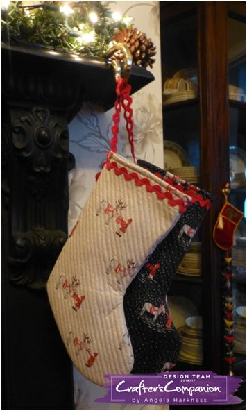 Christmas stockings made using Lewis and Irene 'meeting Santa's reindeer' and 'snowflake' fabrics in grey and natural. Designed by Angela Harkness #crafterscompanion
