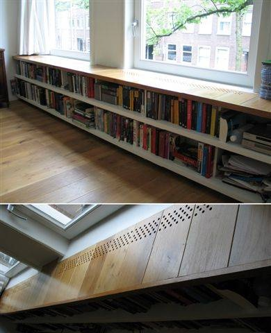 Boekenkast voor verwarming weggewerkt. Daar  word je warm van!