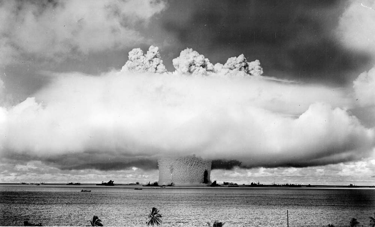 """The famous image of the second Operation Crossroads bomb, the """"Baker"""" explosion, conducted ninety feet underwater, on July 25, 1946. The radioactive fallout was so much more concentrated after this second test, that a third """"Charlie"""" test, scheduled for 1947, was cancelled. Credit: Government photo in the public domain."""