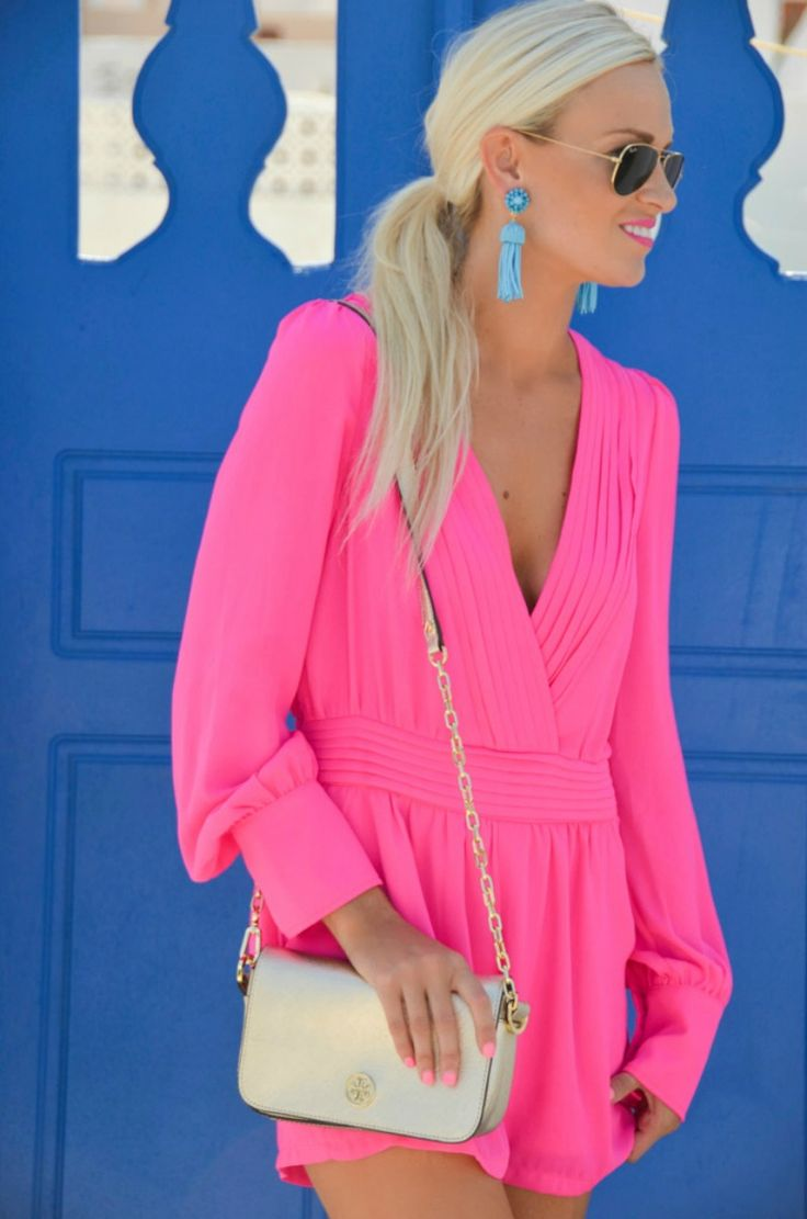 Hot pink romper and blue tassel earrings