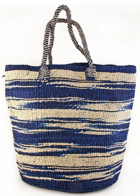 Blue Kenyan Sisal Zebra Print Tote from Swahili Africa Modern. Perfect for food shopping or carrying things to the beach, this chic tote is woven from dyed blue and natural white sisal fibers. Sisal fiber is incredibly tough, so you can stuff this tote full of goodies time and time again. Price $56.00