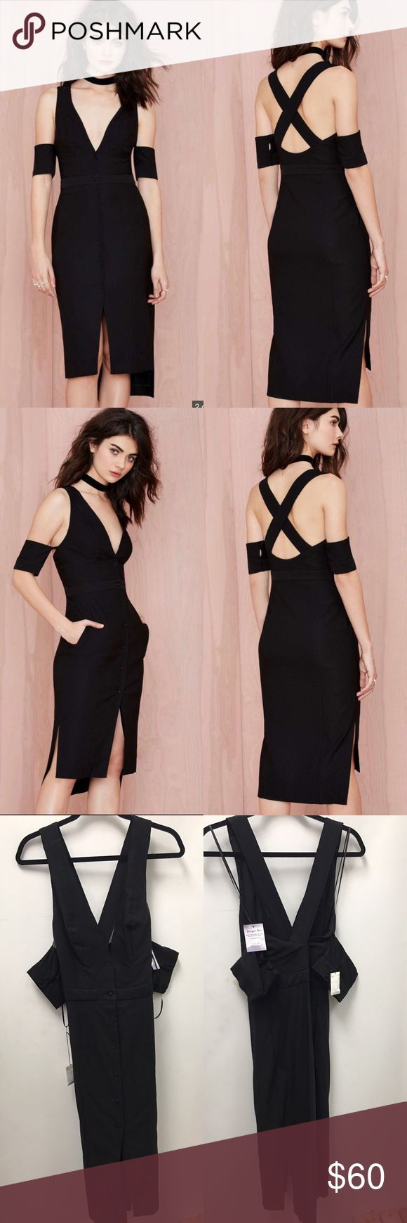 Nasty Gal Wild Forces Cold Shoulder Dress Wild forces couldn't keep us away from this dress. The Wild Forces Dress is made in a ribbed black fabric and features front button closure, arm band detail, v-neck, and crossing straps at back. Unlined, midi length. Looks killer teamed up with platforms and a coatigan, or chunky heels and a clutch. By Nasty Gal. Going OutCut Out, Off The Shoulder Nasty Gal Dresses Midi