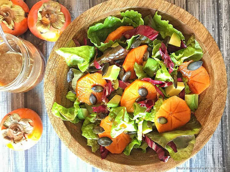 Persimmon Salad with Pepitas, Avocado and Honey Lemon Dressing. I know Fall is here when I can find Persimmons! A beautiful fruit that is oh so sweet when ripe and is packed full of nutrients! This simple salad makes for a great lunch or first course for dinner. This salad is rich in monounsaturated fats, a heart healthy fat. Thanks to the olive oil and avocado! #Healthy #HeartHealthy #Nutrition