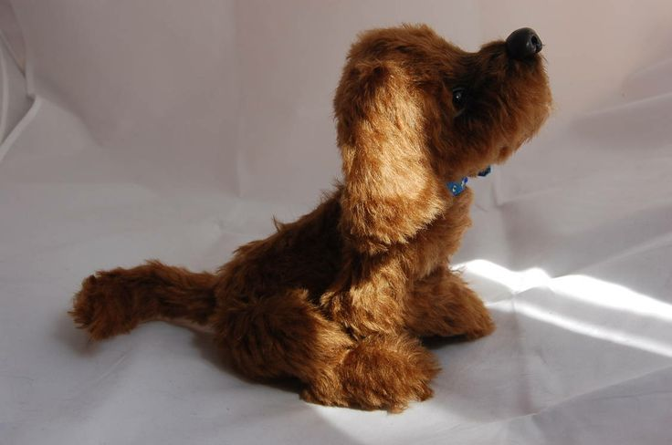 Chocolate Brownie is a brown spaniel teddy-dog made in a realistic style. He is 16 cm height and 27 cm length (from nose to backside). He is made from german chocolate mohair. Chocolate Brownie has 5 pin connections. The body is stuffed with hollow fiber and glass granules. Paws, tail and ears are framed. He can open and close its mouth. Brown glass eyes are painted with acrylics. Nose is made from fimo plastic. He has fabric blue collar with a bell. http://www.bearpile.com/item/83301