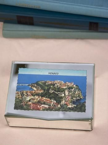 Found at market in the Basque region of France, this pretty mirrored jewelry box was made as a souvenir for the glittering Principality of Monaco. Located on the French Riviera, Monaco is the second smallest and most densely populated country in the world. It has long been a playground for the über-rich and famous, with the highest number of millionaires and billionaires per capita in the world. Ruled by a constitutional monarchy, the current monarch is Prince Albert II, the son of Prince…