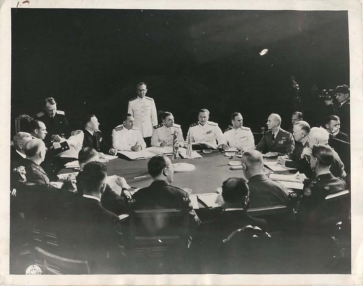 """1945- American and Russian Chiefs of Staff meet in the Cecilienhof Palace in Potsdam, Germany. In the group are Gen. Antenoff (seated in large chair, center rear), Chief of Russian Military Staff; Gen. George C. Marshall (right); Gen. Henry """"Hap"""" Arnold (seated on Gen. Marshall's left); and (on Gen. Marshall's right) Adm. Ernest J. King, Chief of Naval Operations."""