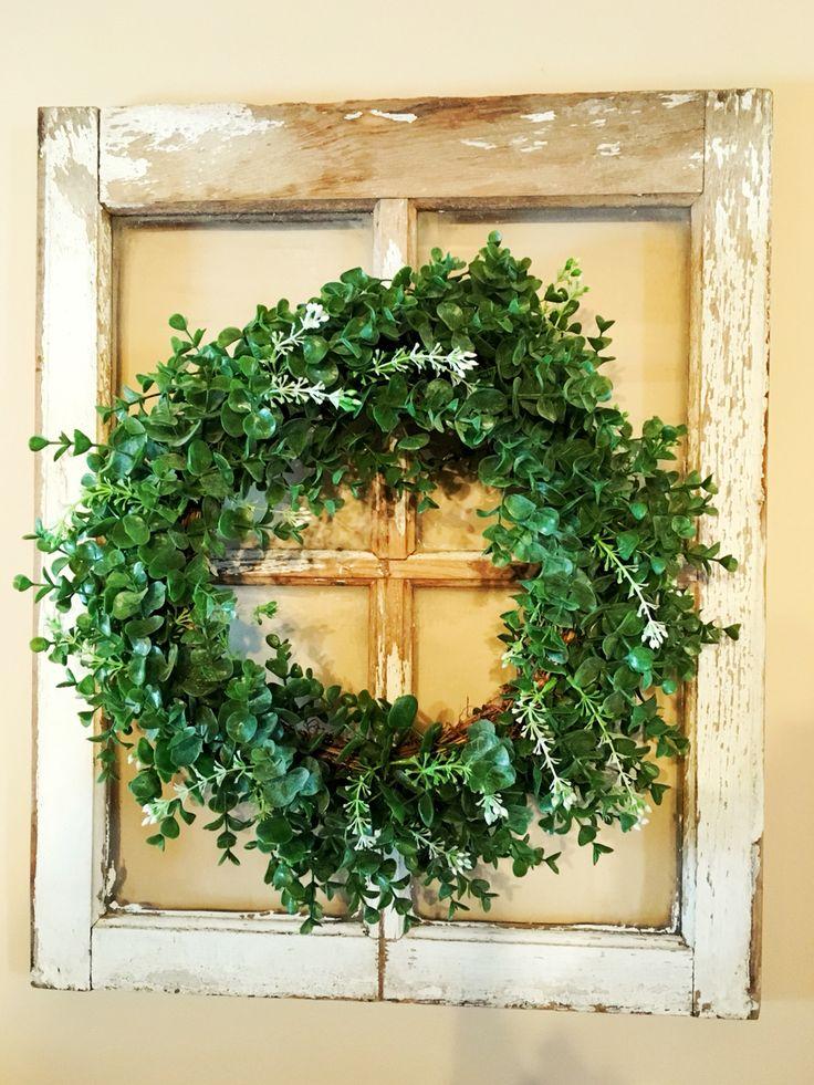 Boxwood wreath on old barn window