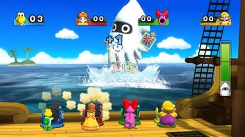 Koopa Troopa, Daisy, Birdo and Wario firing cannons at a giant Blooper in Mario Party 9