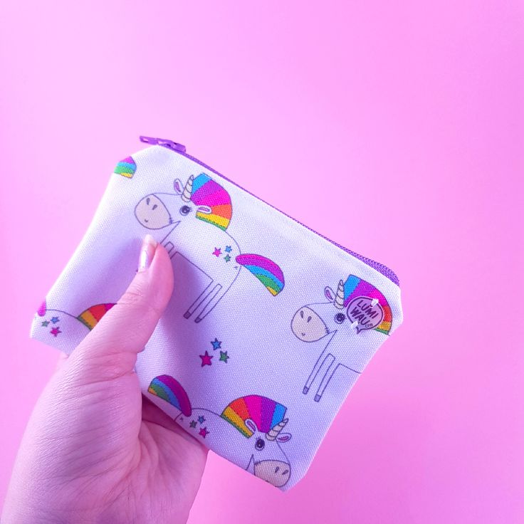 SO cute little unicorn zipper pouch, which will store anything important you need to carry around!