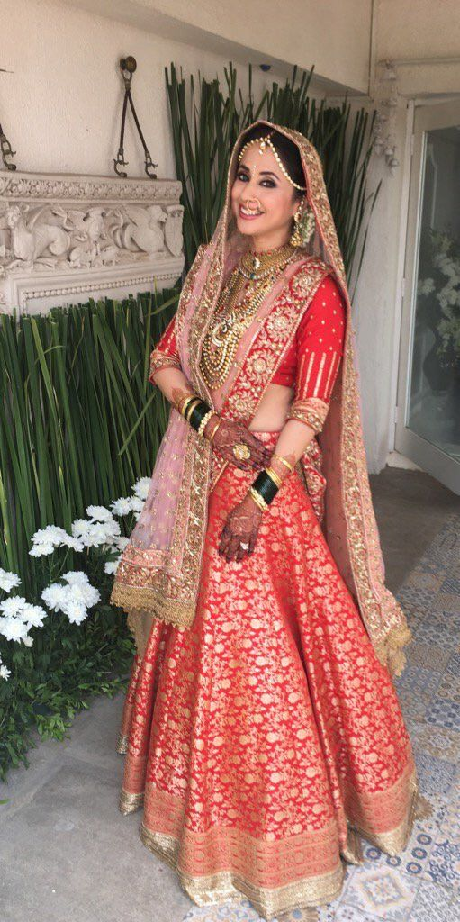 Urmila Matondkar wearing a Manish Malhotra lehenga on her wedding