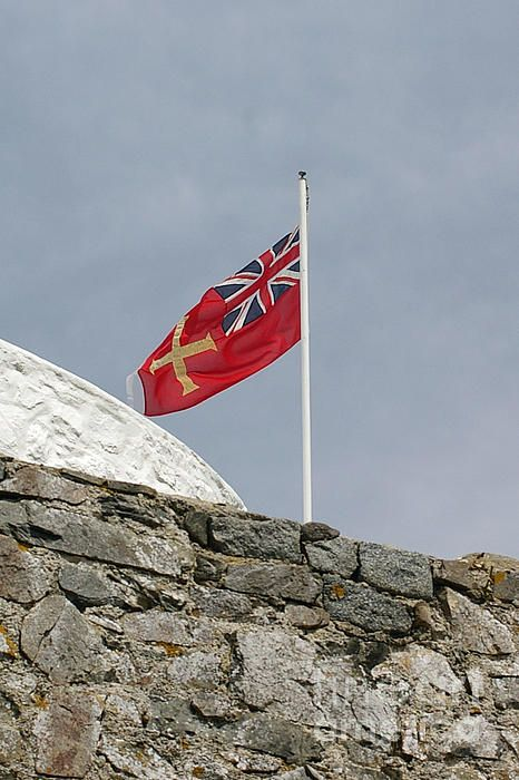 Guernsey Flag photograph by Nancy L. Marshall - Guernsey Flag Fine Art Prints and Posters for Sale #FineArtAmerica  Guernsey flag flying over Fort Grey & Ship Wreck Museum, Guernsey, Channel Islands.