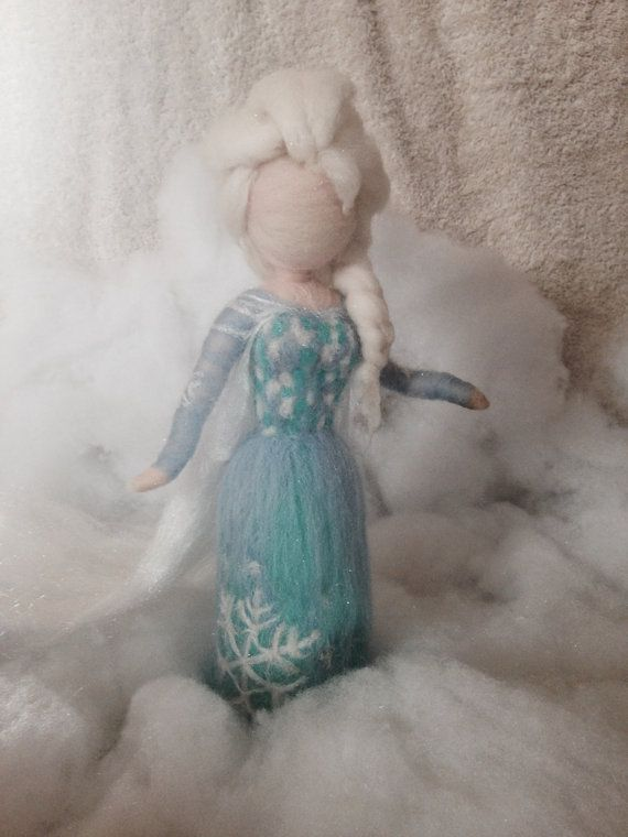 This waldorf inspired wool doll is the sparkling Disney snow queen Elsa. She has silvery snowflakes on her dress and a long train. She would