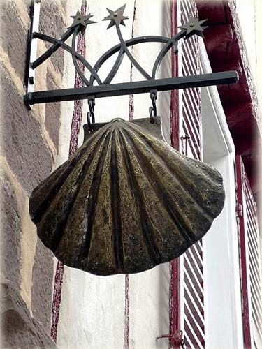 A scallop Shell hanging from a building at the start of the Camino Le Puy Route in St Jean de Pied De Port http://www.followthecamino.com/