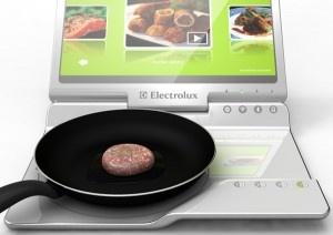(Laptop, Kitchen, & Stove in One) Laptop de Cozinha & Fogão em um: Princípios básicos da cozinha moderna. 4-camadas de elementos de cozinhar de indução, uma tábua de corte eficiente e um computador touchscreen para as suas receitas, downloads e fatos nutricionais.