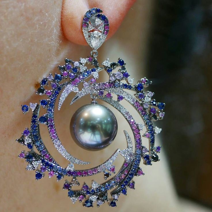 Kick off monday with this beauty by @autorepearls from theStars & GalaxiesCollection. Stars & Galaxiesinvokes the beauty of the universe through an interpretation of interstellar connections that are invisible to the naked eye. Here I am wearing Spiral Galaxy earrings set in 18k white gold with violet and blue sapphires pink and black diamonds and Tahitian pearls. #baselworld2017 @blissfromparis
