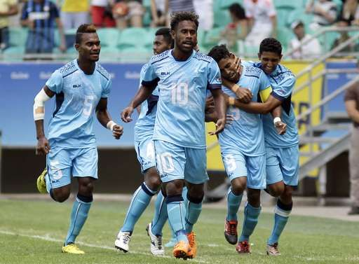 Fiji's Roy Krishna, 2nd right, celebrates his goal with teammates during a group C match of the men's Olympic football tournament between Mexico and Fiji at the Fonte Nova Arena in Salvador, Brazil, Sunday, Aug. 7, 2016. (AP Photo/Arisson Marinho)