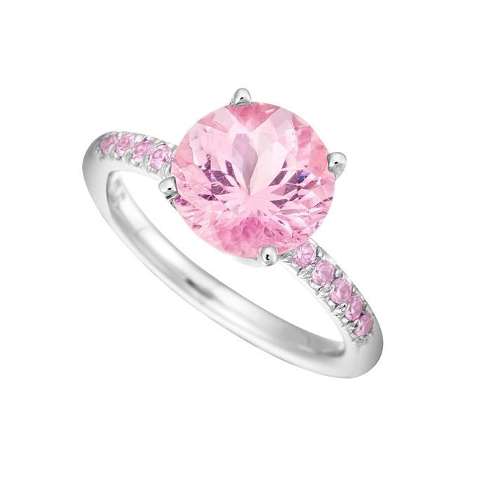 "Brides.com: Pink Engagement Rings. Style RPK801-9, ""Color Candy"" round pink tourmaline solitaire ring with light pink sapphire accents in 18K white gold, $3,300, Jane Taylor  See more round-cut engagement rings."