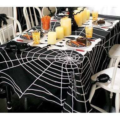 Purchasing a black twin sheet at any superstore for cheap and then covering it with a painted white spider web motif